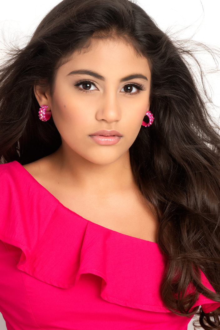 Pageant headshot by Delray Beach, Florida photography Debra Somerville. Young woman with long brown hair, hot pink dress